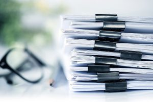 stacks-of-documents-with-binder-clips